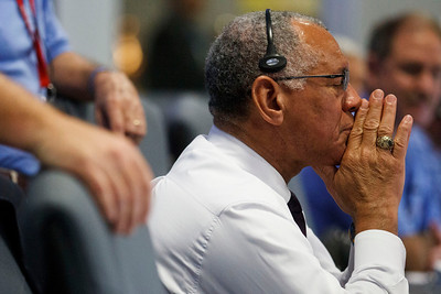 NASA Administrator Charles Bolden closes his eyes as the rover begins its decent to the surface of mars, inside the Spaceflight Operations Facility for NASA's Mars Science Laboratory Curiosity rover at Jet Propulsion Laboratory in Pasadena, Calif., Sunday, Aug. 5, 2012. The Curiosity robot is equipped with a nuclear-powered lab capable of vaporizing rocks and ingesting soil, measuring habitability, and potentially paving the way for human exploration. (AP Photo/Brian van der Brug, Pool)