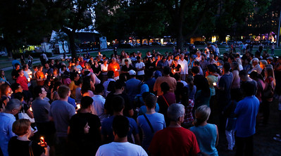 Mourners take part in a candle light vigil for the victims of the Sikh Temple of Wisconsin shooting in Milwaukee Sunday, Aug 5, 2012. An unidentified gunman killed six people at the suburban Milwaukee temple on Sunday in a rampage that left terrified congregants hiding in closets and others texting friends outside for help. The suspect was killed outside the temple in a shootout with police officers. (AP Photo/Jeffrey Phelps)