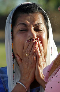 A member of the Sikh Temple of Wisconsin weeps Monday, Aug. 6, 2012, in Oak Creek, Wis., where a gunman killed six people a day earlier, before being killed himself in a shootout with police. Satwant Kaleka, 65, founder and president of the temple, died in the shooting. He was among four priests who died. (AP Photo/M. Spencer Green)