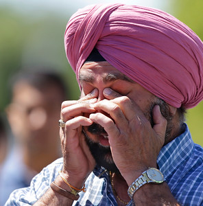 A man reacts outside the Sikh Temple of Wisconsin in Oak Creek, Wis. where a shooting took place on Sunday, Aug. 5, 2012. (AP Photo/Jeffrey Phelps)