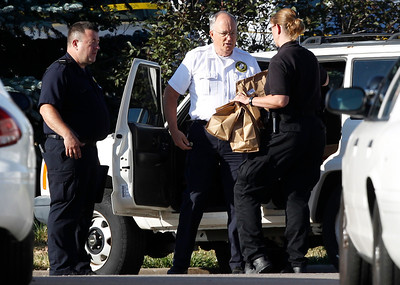 "Officers load bags of evidence into a car outside the Century 16 theater east of the Aurora Mall in Aurora, Colo., on Friday, July 20, 2012. A shooting took place in the theater in which at least 12 people died and scores were injured during the premiere showing of ""The Dark Knight Rises."" (AP Photo/David Zalubowski)"