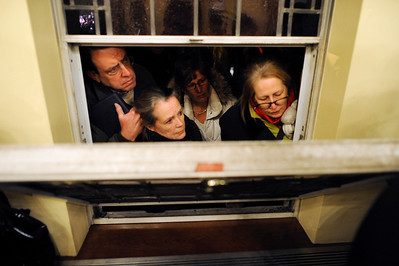 Mourners look in from outside during a vigil service for victims of the Sandy Hook Elementary School shooting, at the St. Rose of Lima Roman Catholic Church in Newtown, Conn. Friday, Dec. 14, 2012. (AP Photo/Andrew Gombert, Pool)