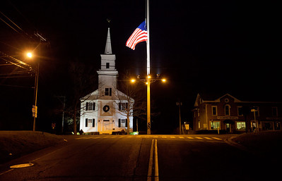 A U.S. flag flies at half-staff on Main Street in honor of the people killed when a gunman opened fire inside a Connecticut elementary school, Saturday, Dec. 15, 2012, in Newtown, Conn. (AP Photo/David Goldman)