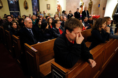 Mourners gather for a vigil service for victims of the Sandy Hook Elementary School shooting, at the St. Rose of Lima Roman Catholic Church in Newtown, Conn. Friday, Dec. 14, 2012.  (AP Photo/Andrew Gombert, Pool)