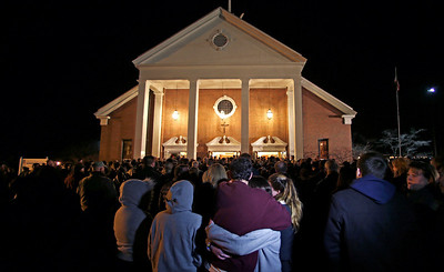 As hundreds stand outside St. Rose of Lima Roman Catholic Church, which was filled to capacity, a couple embrace during a healing service held in for victims of an elementary school shooting in Newtown, Conn., Friday, Dec. 14, 2012.  A gunman opened fire at Sandy Hook Elementary School in Newtown, killing 26 people, including 20 children. (AP Photo/Charles Krupa)