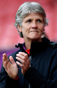United States' head coach Pia Sundhage of Sweden applauds before her team's semifinal women's soccer match against Canada at the 2012 London Summer Olympics, Monday, Aug. 6, 2012, at Old Trafford Stadium in Manchester, England. (AP Photo/Jon Super)