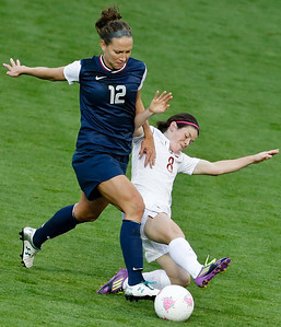 United States' Lauren Cheney, left, and Canada's Diana Matheson, right, vie for the ball during their semifinal women's soccer match at the 2012 Summer Olympics, Monday, Aug. 6, 2012, at Old Trafford in Manchester, England. (AP Photo/Ben Curtis)