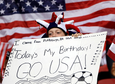 An American fan cheers prior to the semifinal women's soccer match between the United States and Canada at the 2012 London Summer Olympics, in Manchester, England, Monday, Aug. 6, 2012. (AP Photo/Hussein Malla)
