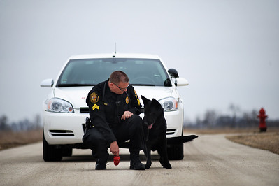 Daniel J. Murphy - dmurphy@shawmedia.com  Sgt. Riley works with Shadow the Marengo police dog on obedience skills Thursday March 1, 2012 in Marengo. Shadow is trained in handler protection, tracking, and article search. The department putting the word out that donations are welcome to help fund Shadow's continued training.
