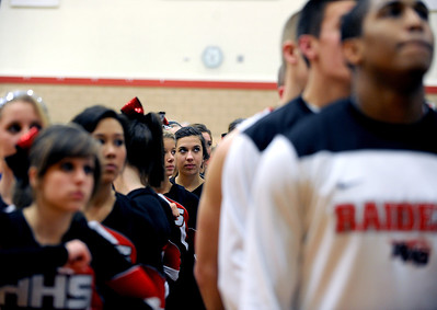 Sarah Nader - snader@shawmedia.com Huntley cheerleaders and the boys basketball team listen to the National Anthem before Friday's IHSA Regional game against Larkin on March 2, 2012 Huntley won, 46-42.