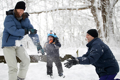 Jenny Kane - jkane@shawmedia.com Dylan Parker, (center) watches as his father Jordan Parker throws a snowball at his mother Jennifer Parker after the Festival of the Sugar Maples tour at Coral Woods Conservation Area in Marengo.