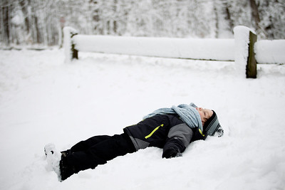 Jenny Kane - jkane@shawmedia.com Lucas Parker makes a snow angel after the Festival of the Sugar Maples at Coral Woods Conservation Area in Marengo.