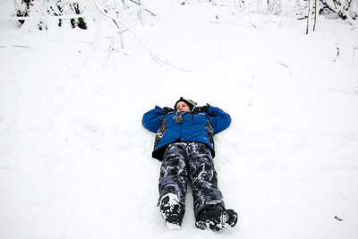 Jenny Kane - jkane@shawmedia.com Kyle Ochwat, 8, lays in the snow while his tour group looks at the maple sap collection process at the Coral Woods Conservation Area The McHenry County Conservation District held its annual Festival of the Sugar Maples in Marengo.