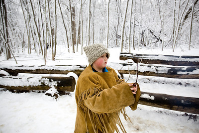 Jenny Kane - jkane@shawmedia.com McHenry County Conservation District volunteer CJ Gillett breaks apart a stick for the camp fire while waiting for another tour group to begin during the annual Festival of the Sugar Maples at Coral Woods Conservation Area in Marengo.
