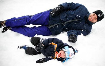 Jenny Kane - jkane@shawmedia.com Jordan Parker plays in the snow with his son Dylan Parker after the Festival of the Sugar Maples tour at Coral Woods Conservation Area in Marengo.