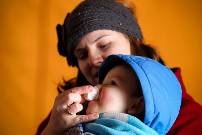 Jenny Kane - jkane@shawmedia.com Jenny Vogt feeds a sample of maple syrup to her son Adam Vogt, 2, during a tour at Festival of the Sugar Maples at Coral Woods Conservation Area in Marengo. The McHenry County Conservation District held the event.
