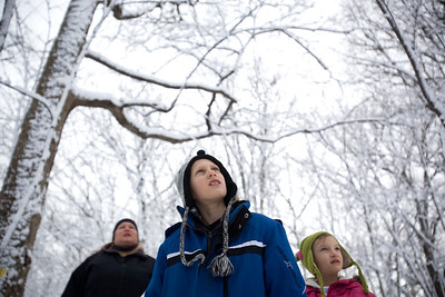 Jenny Kane - jkane@shawmedia.com Kyle Ochwat, 8, (center), his sister Avery Ochwat, 6, (right) and Heidi Marie Paige, (left) look into the trees at Coral Woods Conservation Area as volunteer Phil Vogrinc, of Woodstock, explains how to spot a Maple tree. The McHenry County Conservation District held its annual Festival of the Sugar Maples at Coral Woods Conservation Area in Marengo.