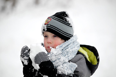 Jenny Kane - jkane@shawmedia.com Lucas Parker tastes a snowball after the Festival of the Sugar Maples at Coral Woods Conservation Area in Marengo.