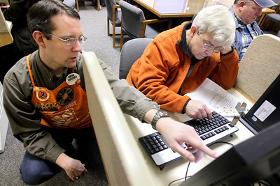Photo by Jenny Kane - jkane@shawmedia.com Home Depot assistant support department supervisor Mark Turnbull helps Wonder lake resident Marc Brzenk fill out an online application to Home Depot during a job fair at the McHenry County Workforce Center in Woodstock. Home Depot is hoping to hire about 200-250 positions. Potential employees received help filling out resumes and applications online.