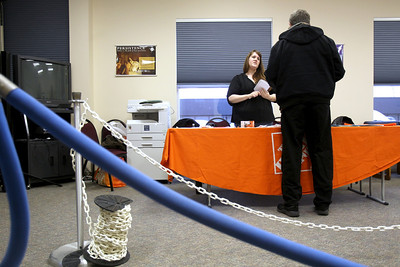 Photo by Jenny Kane - jkane@shawmedia.com Home Depot assistant support department supervisor Heather Skidds talks to Johnsburg resident Kevin Mogg during a job fair at the McHenry County Workforce Center in Woodstock. Home Depot is hoping to hire about 200-250 positions. Potential employees received help filling out resumes and applications online.
