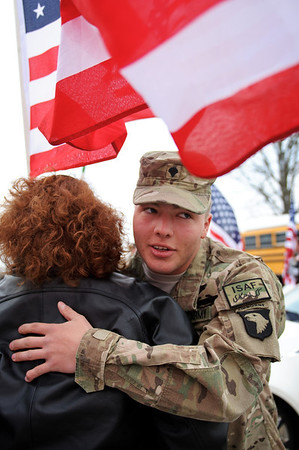 Daniel J. Murphy - dmurphy@shawmedia.com  Spc Donnie Rowden IV hugs a supporter at KC's Cabin Saturday March 3, 2012 in Spring Grove. Donnie was welcomed home by family members, friends and Various veteran's groups.  He is 21 years old and a Pathfinder with the 101st Airborne.  He completed AIT and Jump School at Ft. Benning, GA.  Deploying from Ft. Campbell, KY in February, 2011, the 19 CAB Unit just returned from Afghanistan.
