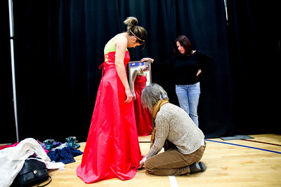 Jenny Kane - jkane@shawmedia.com McHenry high school east campus student Taylor Ley, 18, tries on a prom dress as her grandmother Lucy Delmonico adjusts the hemline and her mother Karin Ley holds a mirror for her to look at the dress during the My Sister's Dress event. The benefit was held at McHenry County College on Sunday. Women from around the area donated their prom dresses to the organization so that hundreds of high school girls could buy them for $25. The proceeds of the benefit went to Big Brothers Big Sisters of McHenry County.