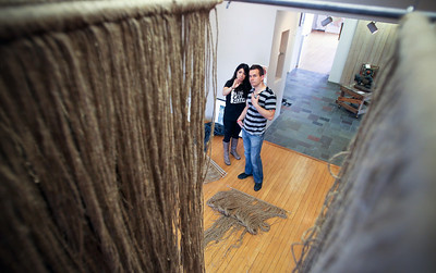 Jenny Kane - jkane@shawmedia.com Natalie Dunham of Nashville Tenn. discusses how many rows of twine to add to her work with her boyfriend Oskar Urbanowicz. Dunham was installing her artwork at the Old Court House Arts Center in Woodstock for the 25th anniversary show of Women's Works.