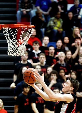 Jenny Kane - jkane@shawmedia.com Huntley's Troy Miller makes a two point basket during the second half of their game against Auburn. Huntley lost to Auburn in the Class 4A Dundee-Crown Sectional 62-48.