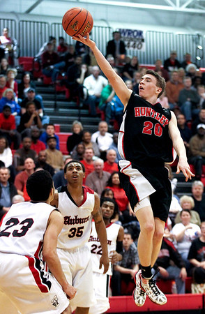 Jenny Kane - jkane@shawmedia.com Huntley's Troy Miller makes a two point basket during the third period of their game against Auburn. Huntley lost to Auburn in the Class 4A Dundee-Crown Sectional 62-48.