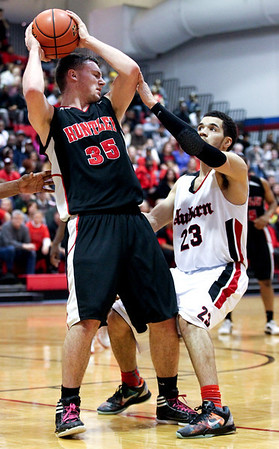 Jenny Kane - jkane@shawmedia.com Huntley's Justin Frederick tries to fend off Auburn's Fred Van Vleet's defense. Huntley lost to Auburn in the Class 4A Dundee-Crown Sectional 62-48.