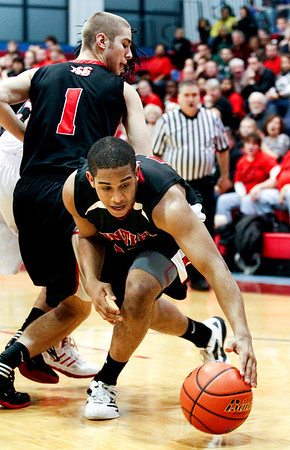 Jenny Kane - jkane@shawmedia.com Huntley's Bryce Only tries to recover a ball that was about to go out of bounds during the second period of their game against Auburn. Huntley lost the Class 4A Dundee-Crown Sectional 62-48.