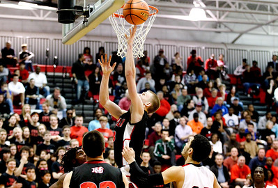 Jenny Kane - jkane@shawmedia.com Huntley's Jake Brock makes a lay-up during the second half of their game against Auburn. Huntley lost to Auburn in the Class 4A Dundee-Crown Sectional 62-48.