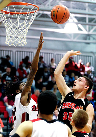 Jenny Kane - jkane@shawmedia.com Huntley's Justin Frederick tries two point shot during their game against Auburn. Huntley lost to Auburn in the Class 4A Dundee-Crown Sectional 62-48.