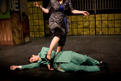 Jenny Kane - jkane@shawmedia.com Mrs. Peacock played by Jackie McNamara walks over Mr. Green played by Jake Cartmell during the GreenRoom Productions rehearsal of Clue the Musical at the Cosman Center in Huntley.