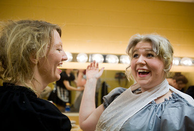 Jenny Kane - jkane@shawmedia.com Jenny Olson, (left) helps Kat McKeown, (right) put on her Mrs. White costume prior to the GreenRoom Productions dress rehearsal of Clue the Musical at the Cosman Center in Huntley.