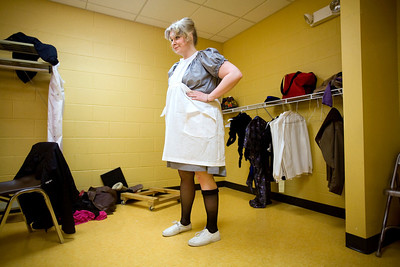 Jenny Kane - jkane@shawmedia.com Kat McKeown looks at herself in the mirror after putting the final touches on her Mrs. White costume prior to the GreenRoom Productions dress rehearsal of Clue the Musical at the Cosman Center in Huntley.