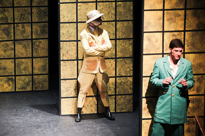 Jenny Kane - jkane@shawmedia.com Colonel Mustard played by Taylor Kras waits in position with Mr. Green played by Jake Cartmell during the GreenRoom Productions dress rehearsal of Clue the Musical at the Cosman Center in Huntley.