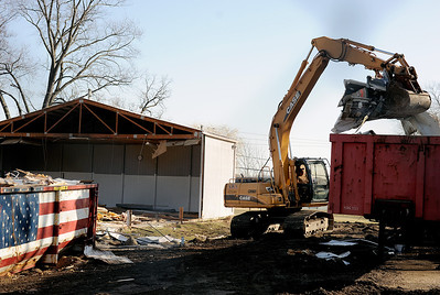 Sarah Nader - snader@shawmedia.com Construction workers start the demolition of the old McCullum Lake village hall located on Orchard Drive on Tuesday, March 6, 2012. A new 6,000 square foot village hall will be built in the location and should be completed this summer.