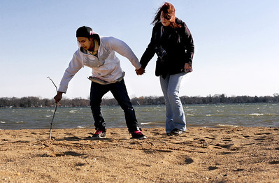 Sarah Nader - snader@shawmedia.com Joseph Escorza (left), 19, of Fox Lake draws a picture in the sand of his girlfriend, Ashleigh Gregory, 19, of Woodstock while they enjoyed the McCullum Lake beach on Tuesday, March 6, 2012.