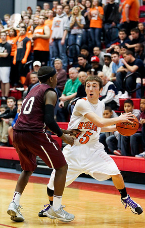 Jenny Kane - jkane@shawmedia.com McHenry's Danny Glick looks to pass during their IHSA Class 4A Dundee-Crown Sectional semifinal game against Elgin.