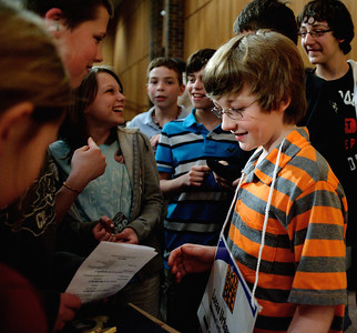 Daniel J. Murphy - dmurphy@shawmedia.com  Family and friends congratulate Lucas Venetucci, 12, after winning the McHenry County Spelling Bee in the 29th round Wednesday March 7, 2012 at McHenry County College in Crystal Lake.