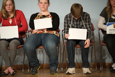 "Daniel J. Murphy - dmurphy@shawmedia.com  McHenry Middle School's Daniel Venteucci (right) bows his head after after misspelling ""gardenia"" in the McHenry County Spelling Bee Wednesday March 7, 2012 at McHenry County College in Crystal Lake. Lucas Urbanski went on to win the competition in the 29th round. Also pictured Tess Devinger (left) and Brianna Nims (center)."