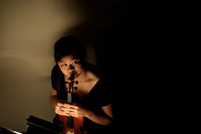 "Daniel J. Murphy - dmurphy@shawmedia.com  Tina Yan of McHenry waits to play the violin in a dress rehearsal of ""Chess"" Thursday March 8, 2012 at McHenry West High School in McHenry.  ""Chess"" is a pop-rock musical written by ABBA's Benny Andersson and Bjorn Ulvaeus."