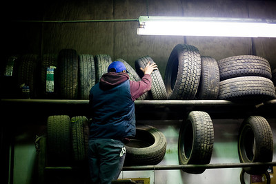 Jenny Kane - jkane@shawmedia.com Ed's Automotive mechanic Mario Bello organizes tires at the shop after balancing a tire for customer Woody Thomforda. Ed's Automotive has been in business in Woodstock for 48 years.