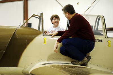 Daniel J. Murphy - dmurphy@shawmedia.com  Neil Anderson of Spring Grove lets Kyle Zetterland, 13, of Cary explore his Yak 52 experimental aircraft at a free event Saturday March 10, 2012 at Galt Airport in Wonder Lake, IL.