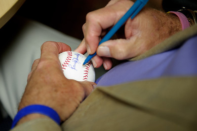 Daniel J. Murphy - dmurphy@shawmedia.com  Former Cubs catcher Randy Hundley autographs a baseball for Karen Koenig of McHenry Saturday March 10, 2012 at Superior Health Club in Crystal Lake. Superior held it's grand opening Saturday with an autograph session from Chicago sports celebrities.