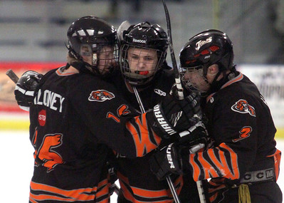 Jeff Krage/For the Northwest Herald CCM's Tyler Aitken (center) is congratulated by teammates Pat Maloney (left) and Kyle Hawley after evening the score at one in the first period of Sunday's game against Lincoln-Way at the Edge Ice Arena in Bensenville. Bensenville 3/11/12