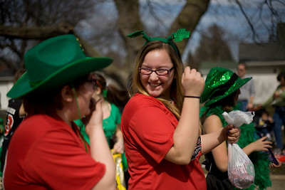 Lance Booth - lbooth@shawmedia.com Keelia Riley, right, 12 laughs with Mary Kate Murgatroyd, both of McHenry, during the 3rd annual St. Patrick's Day Parade in McHenry on Sunday, March 11, 2012. Locals from throughout McHenry watched on the sides of the streets. The Rotary Club of McHenry-Sunrise sponsored the event.