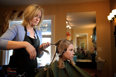"Daniel J. Murphy - dmurphy@shawmedia.com  Caitlin Whitney of Crystal Lake cuts Conner Stevens', 11, of Cary hair Tuesday March 13, 2012 at International Hairways in Crystal Lake. Conner grew out his hair for over a year in order to donate it to Locks of Love on behalf of his godmother, Auntie ""Ju Ju"" Julie Mc Dillon who is a breast cancer survivor."