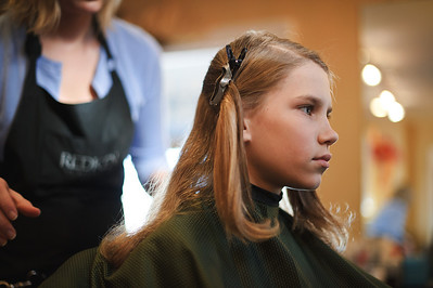 "Daniel J. Murphy - dmurphy@shawmedia.com  Caitlin Whitney of Crystal Lake prepares to cut Conner Stevens', 11, of Cary hair Tuesday March 13, 2012 at International Hairways in Crystal Lake. Conner grew out his hair for over a year in order to donate it to Locks of Love on behalf of his godmother, Auntie ""Ju Ju"" Julie Mc Dillon who is a breast cancer survivor."